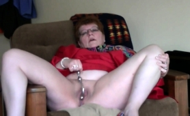 naughty-redhead-granny-gives-her-cunt-the-attention-it-needs