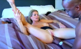 busty-blonde-milf-has-a-black-cock-deeply-invading-her-pussy
