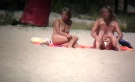 two-busty-milfs-expose-their-wonderful-bodies-on-the-beach