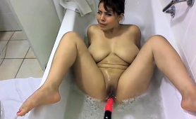 big-breasted-brunette-fucks-her-favorite-toy-in-the-bathtub