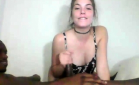 striking-young-brunette-has-fun-with-a-black-guy-on-webcam