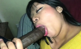 mature-asian-lady-wraps-her-lips-around-a-thick-black-pole