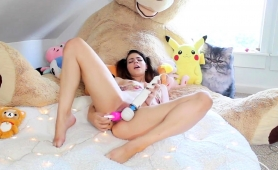 pigtailed-camgirl-plays-with-her-favorite-toys-on-the-bed