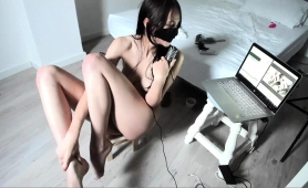 masked-asian-camgirl-puts-her-splendid-body-on-display