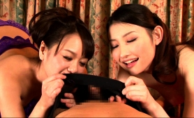 two-wonderful-japanese-girls-teasing-and-pleasing-a-cock